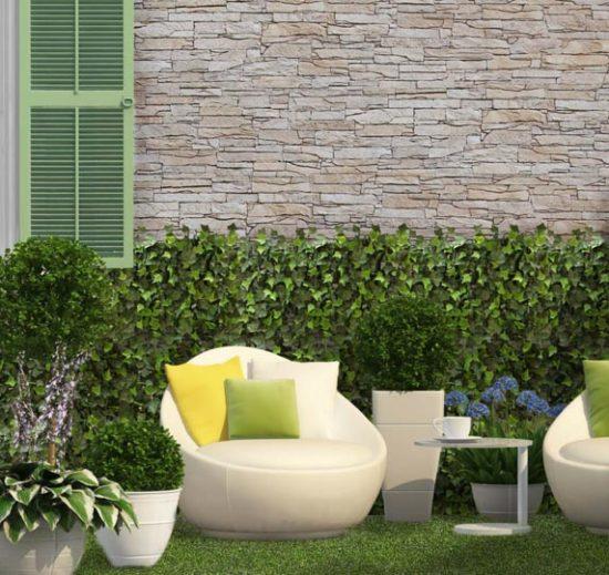 Salon extérieur avec un mur en pierre de parement mathios isola clair