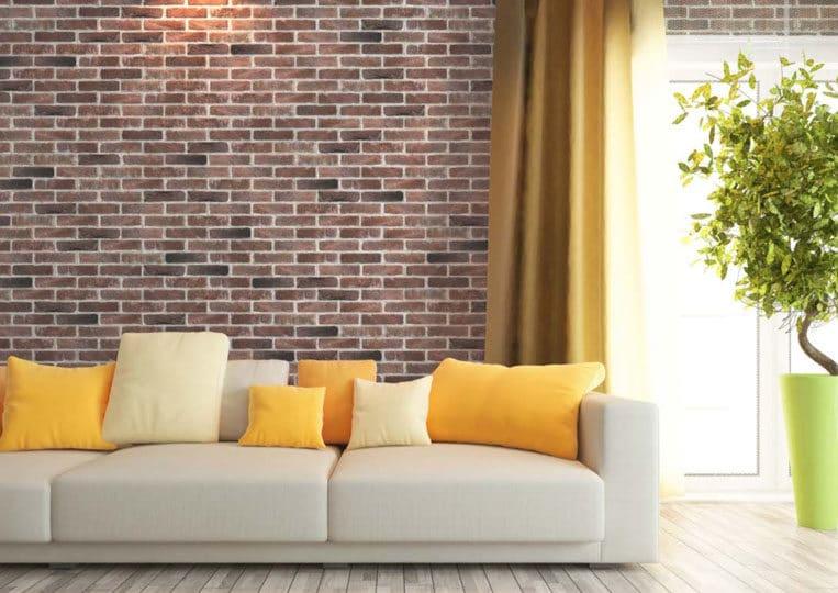 Salon avec un pant de mur en pierre de parement mathios masterbrick