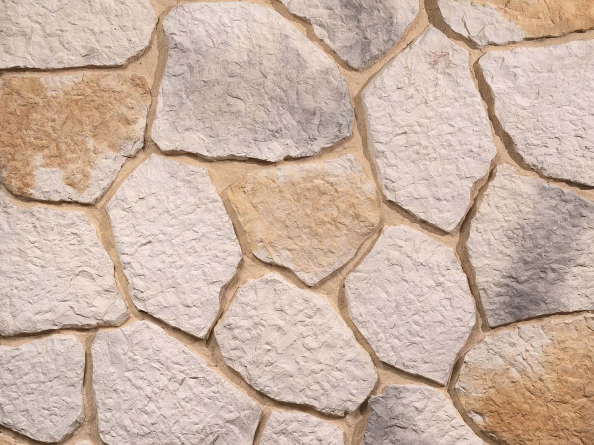 Mur en pierre reconstituée mathios ekali