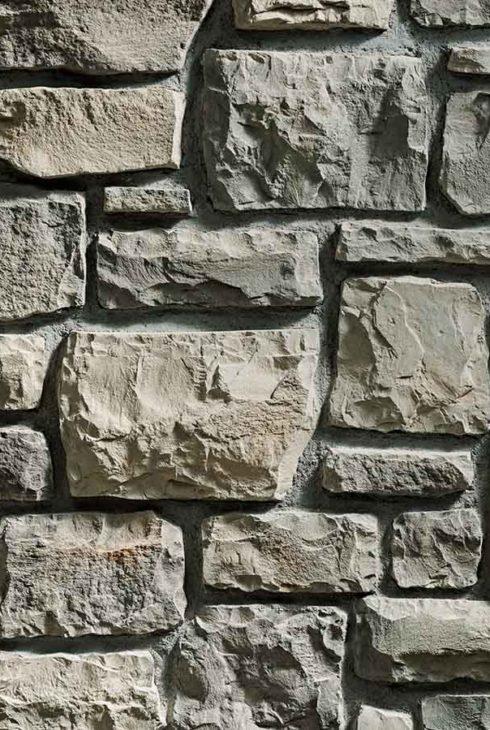 Mur en pierre reconstituée rastone masso de couleur olive