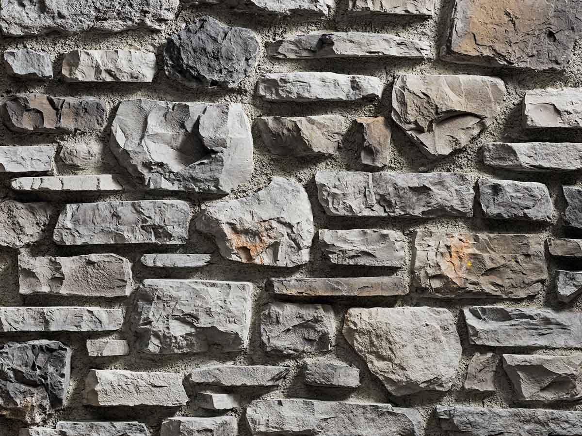 Mur en pierre reconstituée rastone rupe de couleur grise