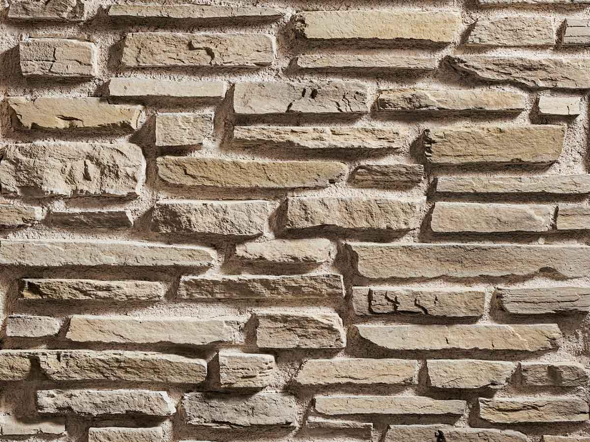 Mur en pierre reconstituée rastone sierra de couleur sable