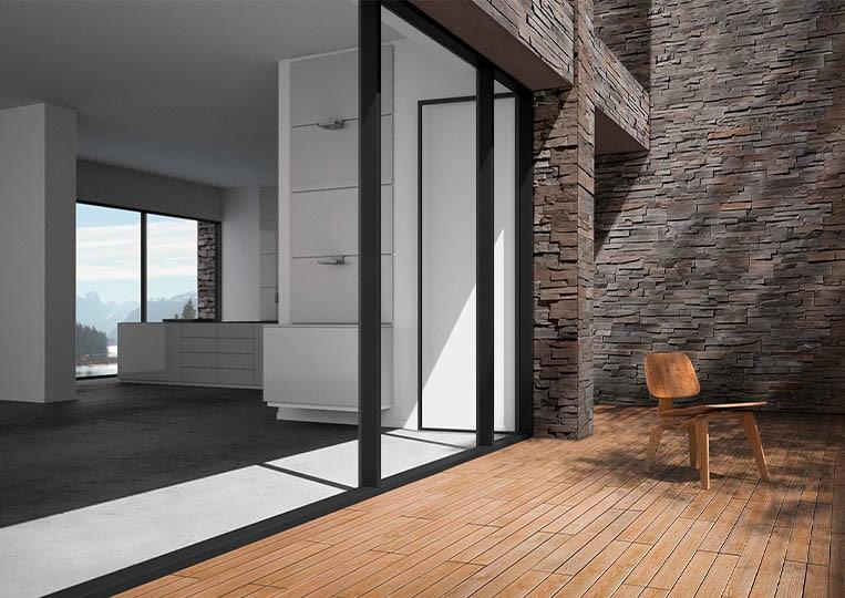Porte donnant sur une terasse extérieure avec un pant de mur en pierre de parement acl royal gris