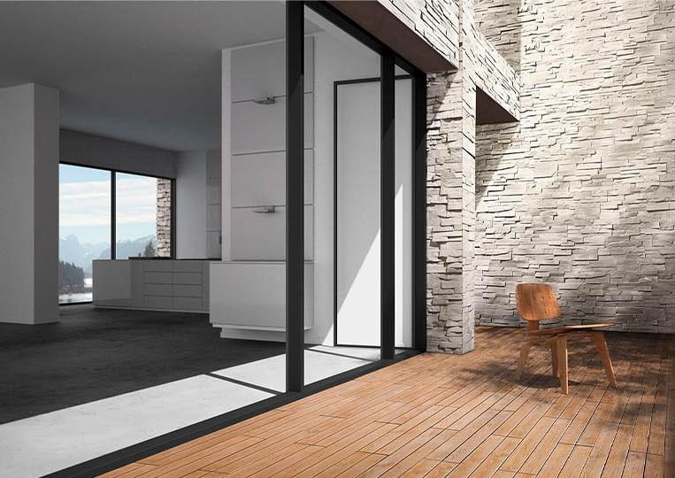 Porte donnant sur une terasse extérieure avec un pant de mur en pierre de parement acl royal clair