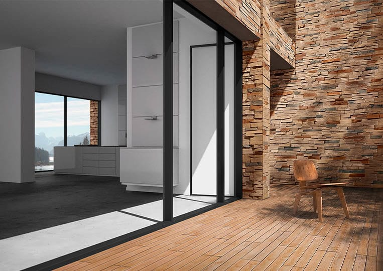 Porte donnant sur une terasse extérieure avec un pant de mur en pierre de parement acl royal café