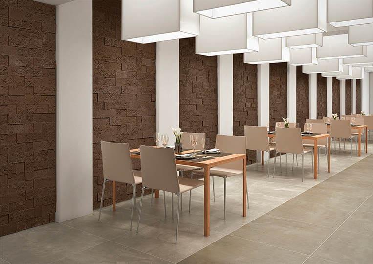 Intérieur de restaurant avec un pant mur en pierre de parement acl stone cork café foncé