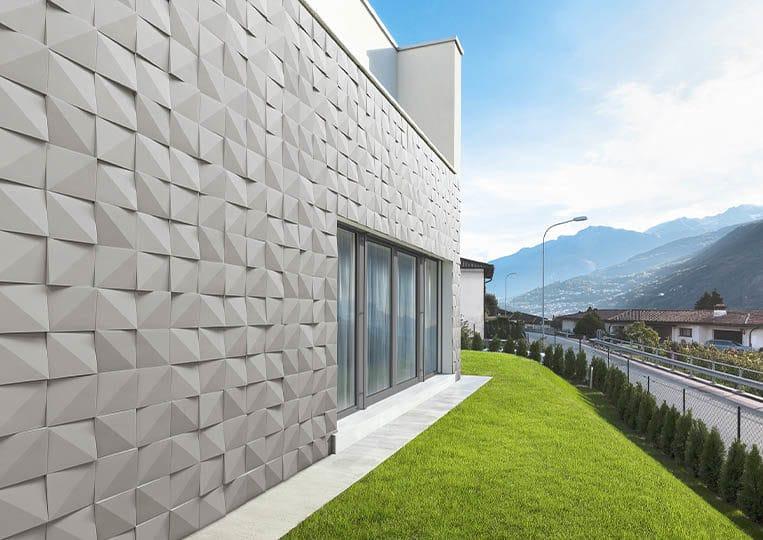 Côté extérieur d'une maison en pierre de parement acl vertices gris