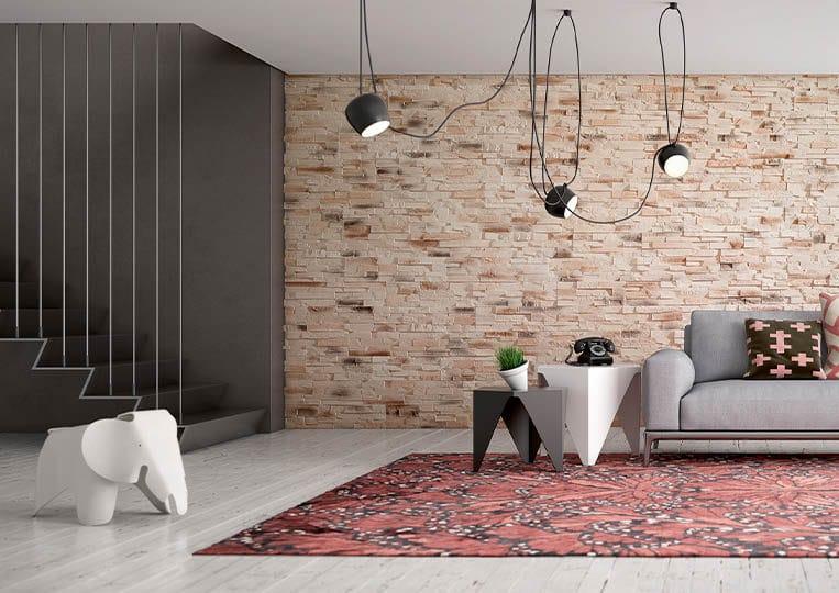 Salon moderne avec un pant de mur en pierre reconstituée acl caster sable