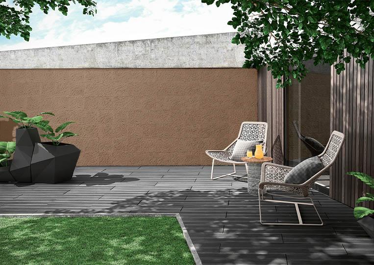 Terasse extérieure de jardin avec un pant de mur en pierre reconstituée couleur café acl cubus café