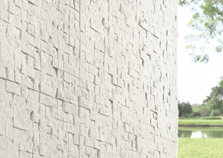 Coin de mur extérieur en pierre reconstituée couleur clair acl cubus