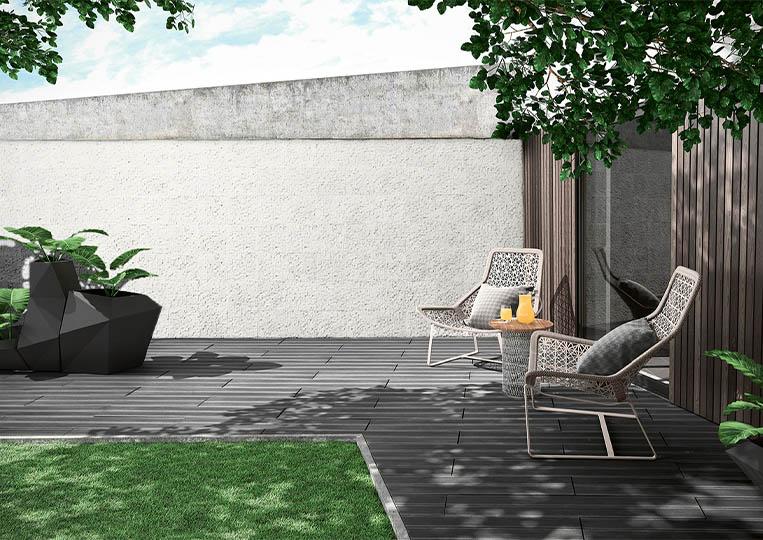 Terasse extérieure de jardin avec un pant de mur en pierre reconstituée couleur clair acl cubus gris