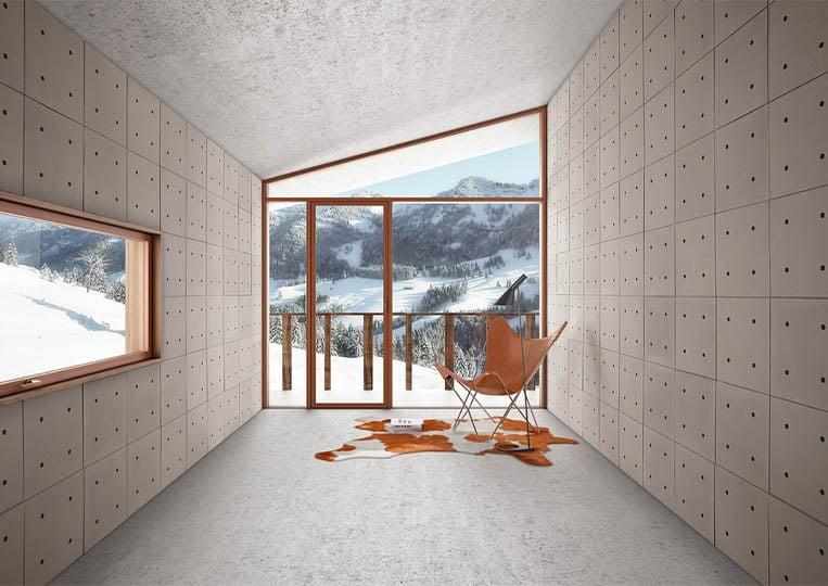 Intérieur moderne vue sur montagnes avec des murs en pierre reconstituée acl hando café