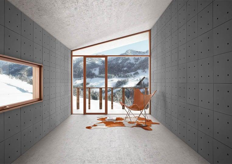Intérieur moderne vue sur montagnes avec des murs en pierre reconstituée acl hando gris