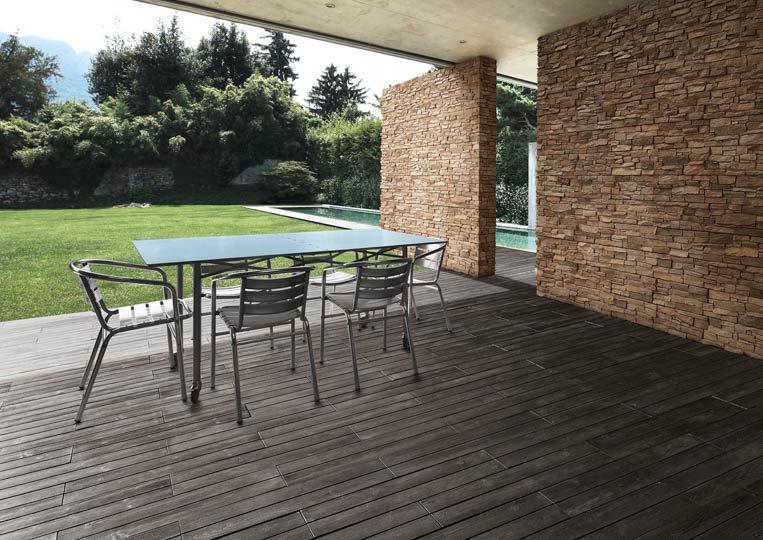 Terasse extérieure couverte avec table à manger et un sol imitation parquet anthracite acl madeira deck classic