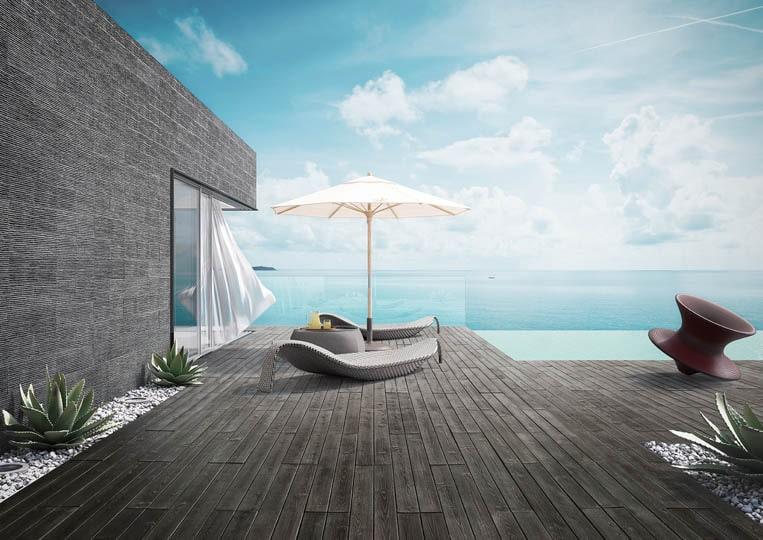 Terasse extérieure avec transat, parasol et vue sur mer avec un sol imitation parquet anthracite acl madeira deck classic
