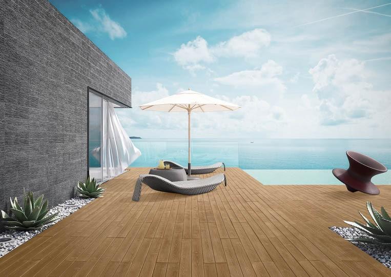 Terasse extérieure avec transat, parasol et vue sur mer avec un sol imitation parquet café acl madeira deck classic