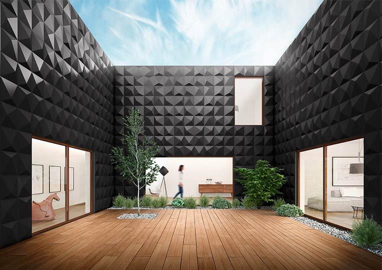 Vue en contre plongée d'une terasse extérieure entourée de mur en pierre reconstituée couleur noir acl prisma