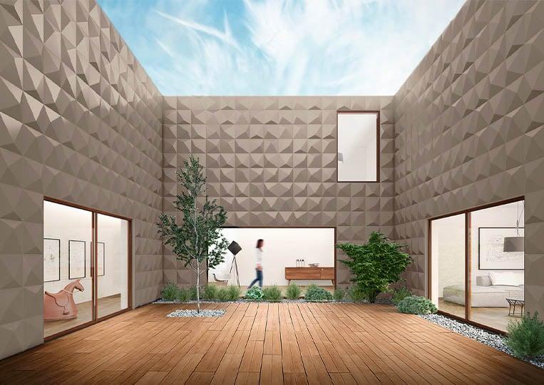 Vue en contre plongée d'une terasse extérieure entourée de mur en pierre reconstituée couleur café acl prisma