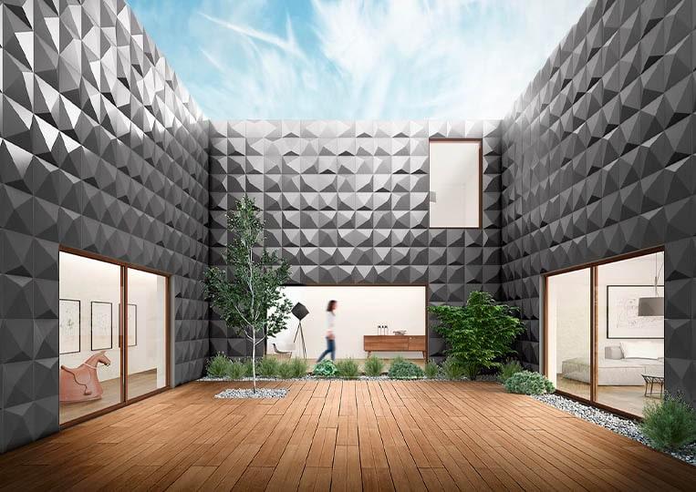 Vue en contre plongée d'une terasse extérieure entourée de mur en pierre reconstituée couleur gris acl prisma