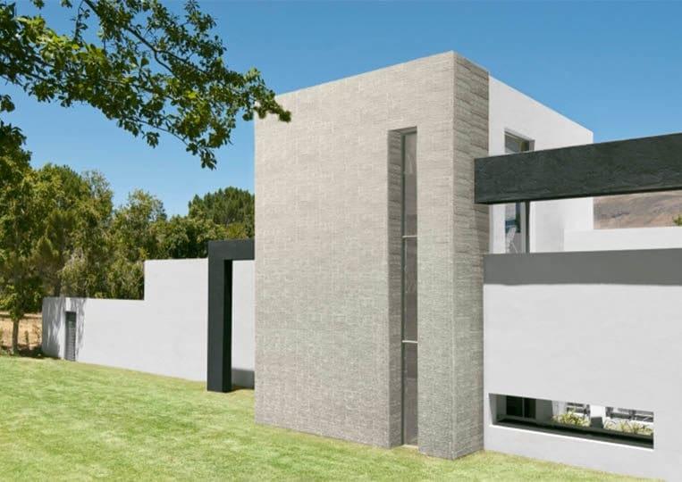 Devanture de maison en pierre reconstituée acl riscado de couleur clair