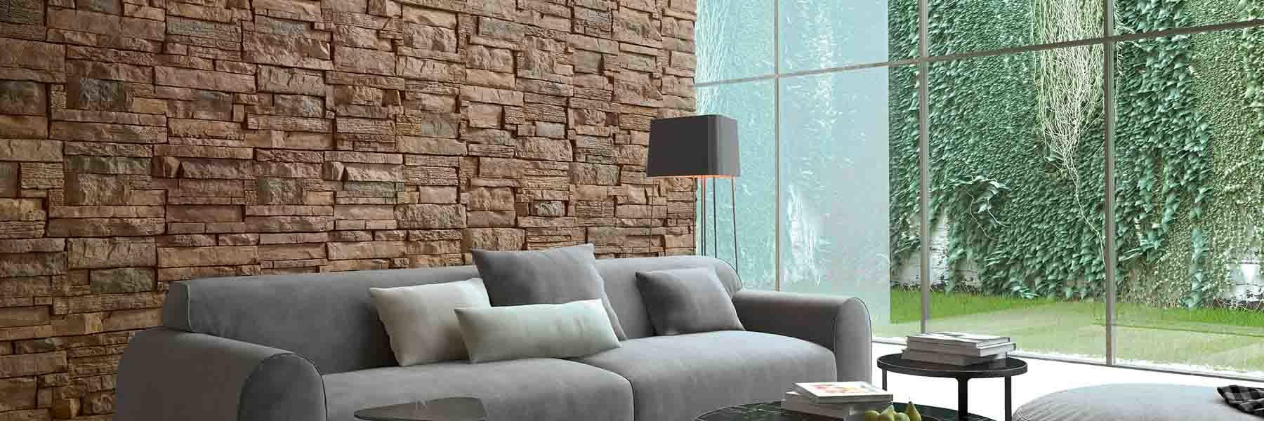 Salon intérieur avec un pan de mur en pierre reconstituée acl nisa