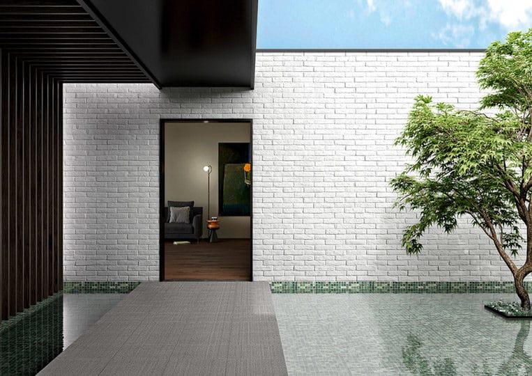 Mur d'entrée en pierre de parement acl cementbrick couleur clair