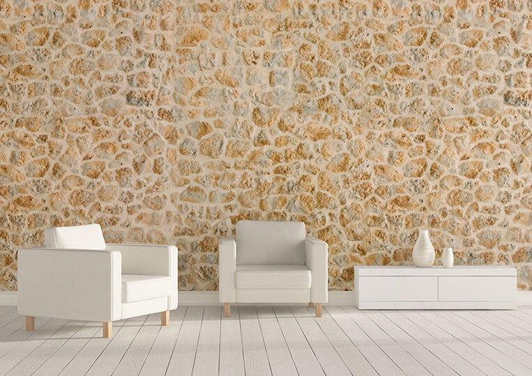 petit salon avec un mur en pierre de parement timanfaya