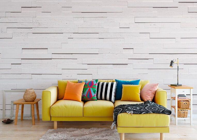 Salon avec un mur en pierre de parement reconstituée tivoli