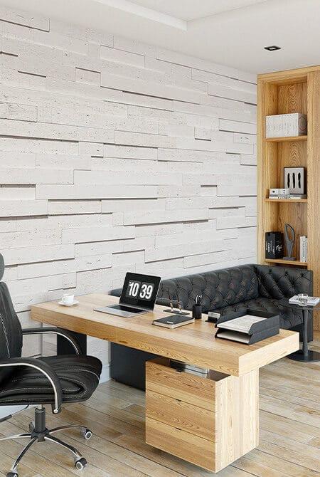 Bureau avec un pans de mur en pierre de parement tivoli